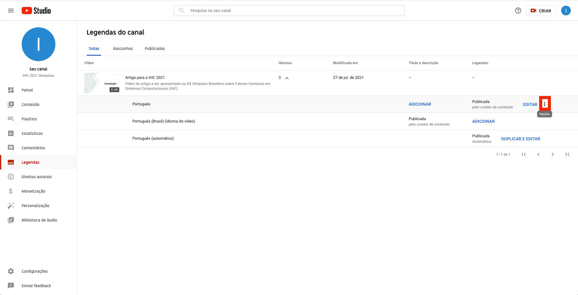 Captura de tela do YouTube Studio. Página de legendas do canal, com legendas do vídeo expandida e destaque para o ícone de opções - representado por três pontinhos, um abaixo do outro. O destaque é feito com um borda quadrada e vermelha